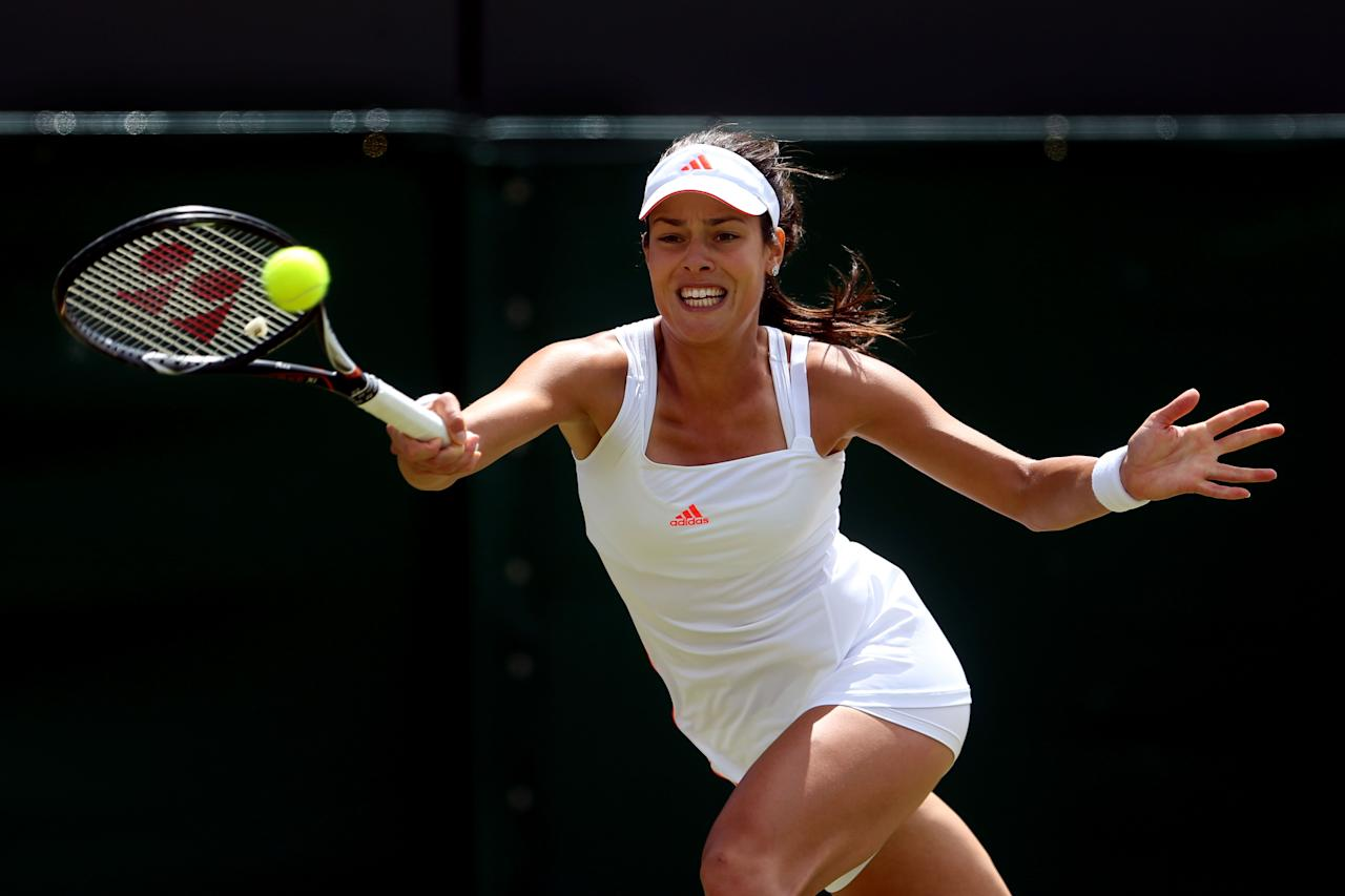LONDON, ENGLAND - JUNE 30: Ana Ivanovic of Serbia returns a s shot during her Ladies' Singles third round match against Julia Goerges of Germany on day six of the Wimbledon Lawn Tennis Championships at the All England Lawn Tennis and Croquet Club at Wimbledon on June 30, 2012 in London, England.  (Photo by Julian Finney/Getty Images)