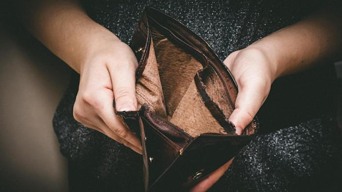 Old empty wallet in the hands .
