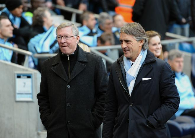 "Manchester United manager Alex Ferguson (L) and Manchester City's Italian manager Roberto Mancini speak before the start of their English Premier League football match at The Etihad stadium in Manchester, north-west England on April 30, 2012. AFP PHOTO/PAUL ELLIS  RESTRICTED TO EDITORIAL USE. No use with unauthorized audio, video, data, fixture lists, club/league logos or ""live"" services. Online in-match use limited to 45 images, no video emulation. No use in betting, games or single club/league/player publications.PAUL ELLIS/AFP/GettyImages"