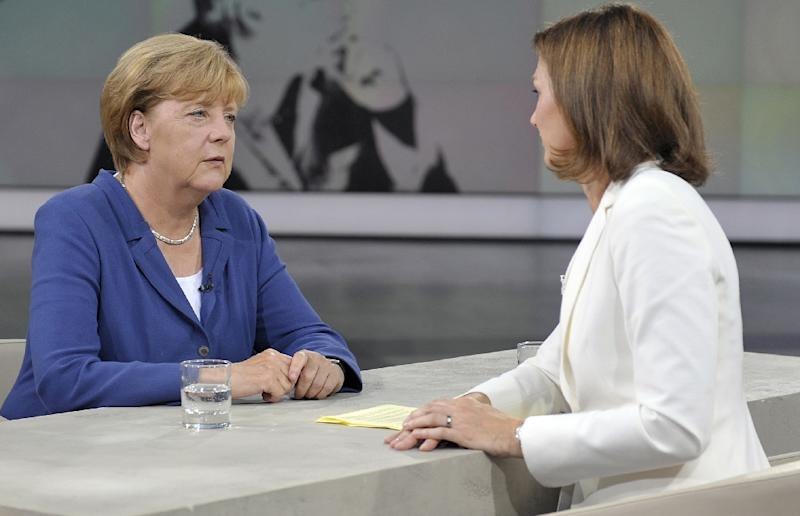 """This photo made available by public broadcaster ZDF shows German Chancellor Angela Merkel (L) during recording of the """"Summer Interview"""" with ZDF's Bettina Schausten in their studio in Berlin on August 16, 2015 (AFP Photo/Jurgen Detmers)"""