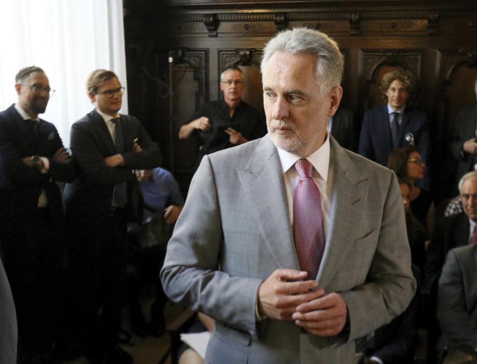 Ukrainian oligarch Dymitro Firtash waits for the start of his trial at the Austrian supreme court in Vienna, Austria, Tuesday, June 25, 2019. Austrian supreme court rules on extradition case of Ukrainian oligarch Dymitro Firtash to the US. (AP Photo/Ronald Zak)
