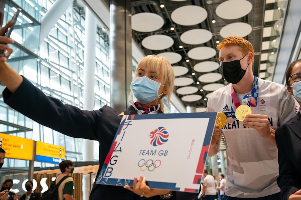 Tom Dean poses for a selfie at Heathrow (Aaron Chown/PA) (PA Wire)