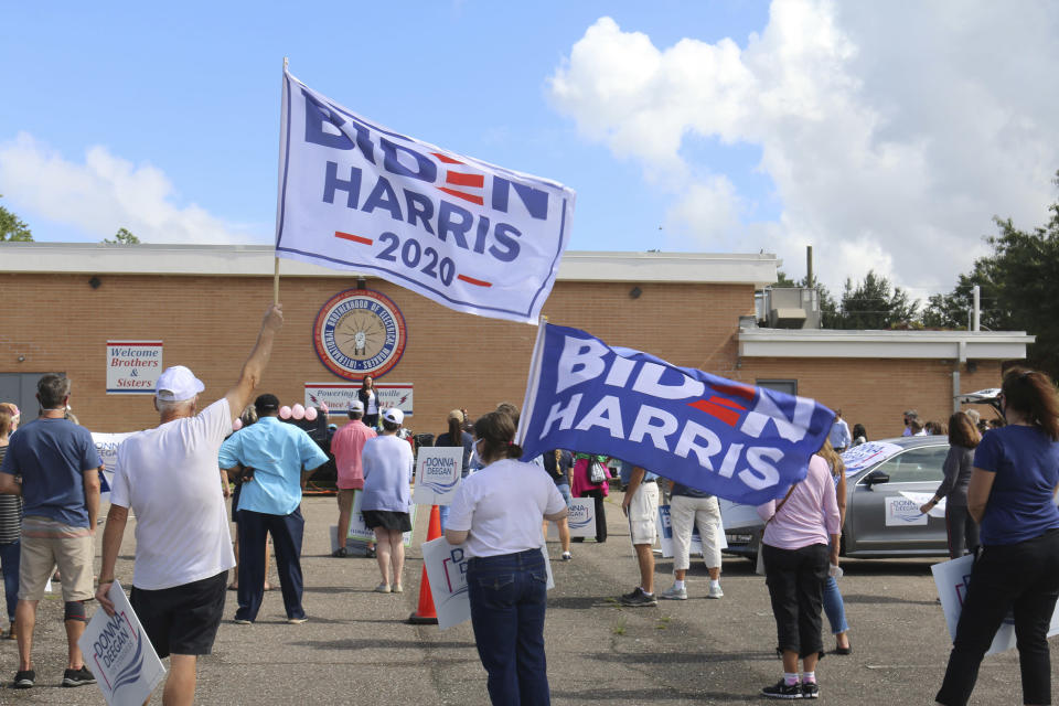 Democrats take part in a rally outside a union hall in Jacksonville, Fla., on Thursday, Oct. 22, 2020, as Florida Agriculture Commissioner Nikki Fried speaks. Democrats hope to make deeper political strides in Jacksonville, which is emerging as the newest battleground in the swing state of Florida. (AP Photo/Bobby Caina Calvan)