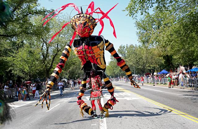 <p>Costumed dancers move about during the annual West Indian Day Parade on September 03, 2018 in Brooklyn. (Photo by Yana Paskova/Getty Images) </p>