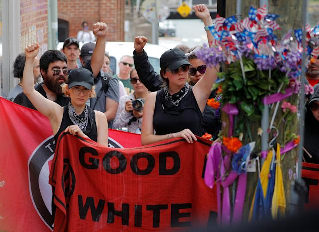 "<p>A group wearing anti-fascist labels visits the site where Heather Heyer was killed during the 2017 Charlottesville ""Unite the Right"" protests in Charlottesville, Va., Aug. 11, 2018. (Photo: Brian Snyder/Reuters) </p>"