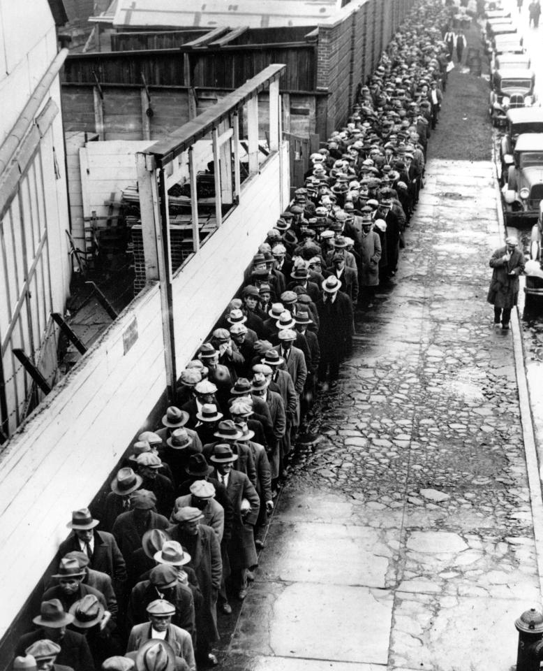 A long line of jobless and homeless men wait outside to get free dinner at New York's municipal lodging house in the winter of 1932-33 during the Great Depression.  (AP Photo)