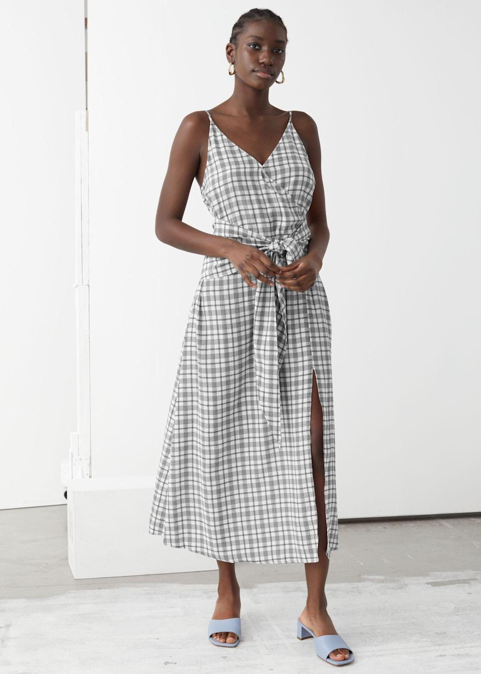 """<br> <br> <strong>& Other Stories</strong> V-Neck Waist Tie Midi Dress, $, available at <a href=""""https://go.skimresources.com/?id=30283X879131&url=https%3A%2F%2Fwww.stories.com%2Fen_usd%2Fclothing%2Fdresses%2Fmidi-dresses%2Fproduct.v-neck-waist-tie-midi-dress-black.0869913004.html"""" rel=""""nofollow noopener"""" target=""""_blank"""" data-ylk=""""slk:& Other Stories"""" class=""""link rapid-noclick-resp"""">& Other Stories</a>"""