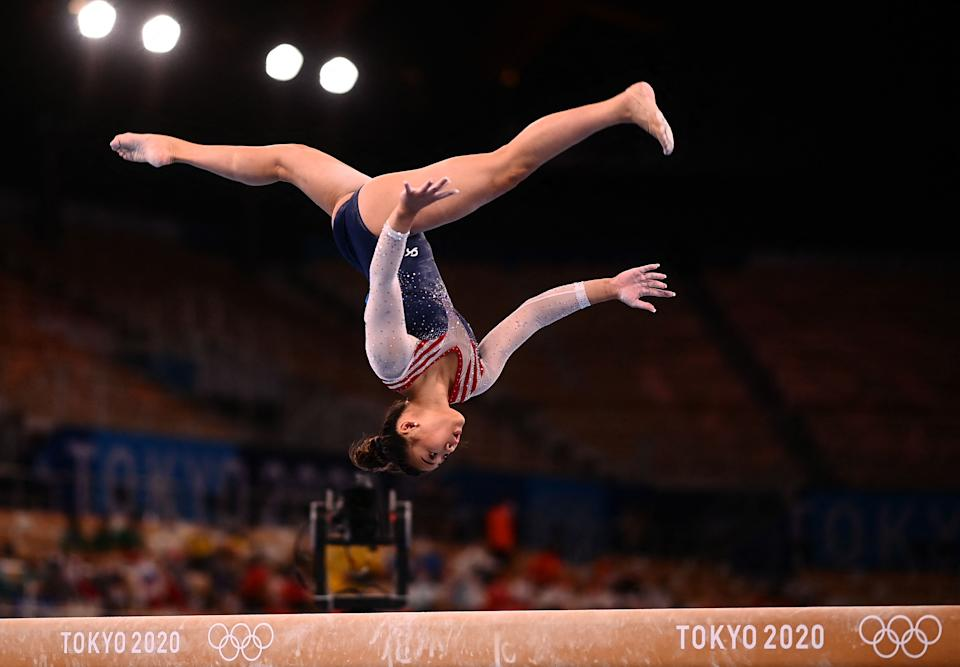 TOPSHOT - USA's Sunisa Lee competes in the balance beam event of the artistic gymnastics women's all-around final during the Tokyo 2020 Olympic Games at the Ariake Gymnastics Centre in Tokyo on July 29, 2021. / AFP / Loic VENANCE