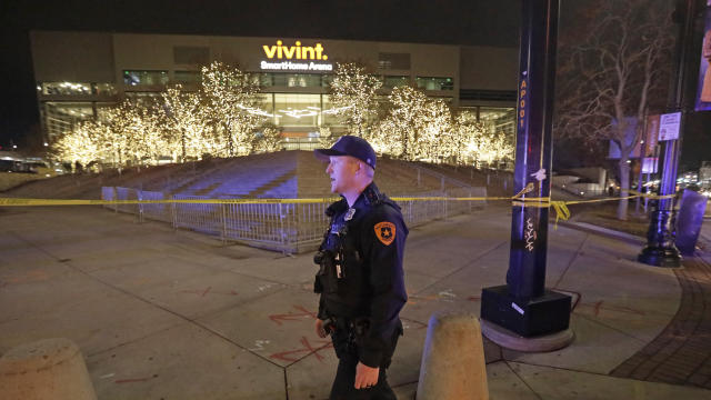 A Salt Lake City police officer stands guard in front of Vivint Smart Home Arena after the Utah Jazz's home had been evacuated because of a suspicious package following the team's NBA basketball game against the Golden State Warriors on Friday, Nov. 22, 2019, in Salt Lake City. Most fans had already left the building when players, coaches and reporters were instructed to leave the arena following Utah's 113-109 victory. (AP Photo/Rick Bowmer)