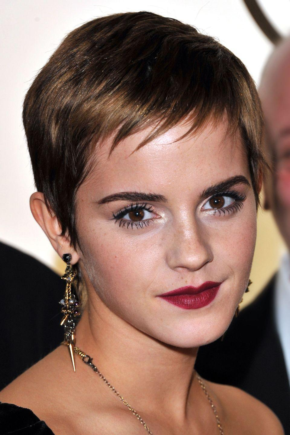 <p>Actress Emma Watson used plenty of hairspray to make her piecey bangs stay in place. </p>