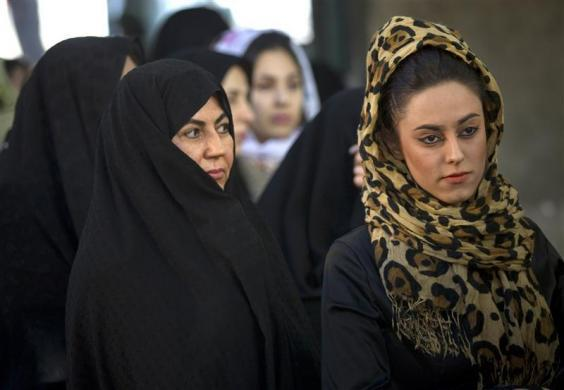 Women wait in line to vote for the parliamentary election in a mosque in south Tehran March 2, 2012.