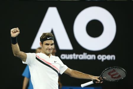 Tennis - Australian Open - Rod Laver Arena, Melbourne, Australia, January 18, 2018. Switzerland's Roger Federer celebrates winning his match against Germany's Jan-Lennard Struff. REUTERS/Thomas Peter
