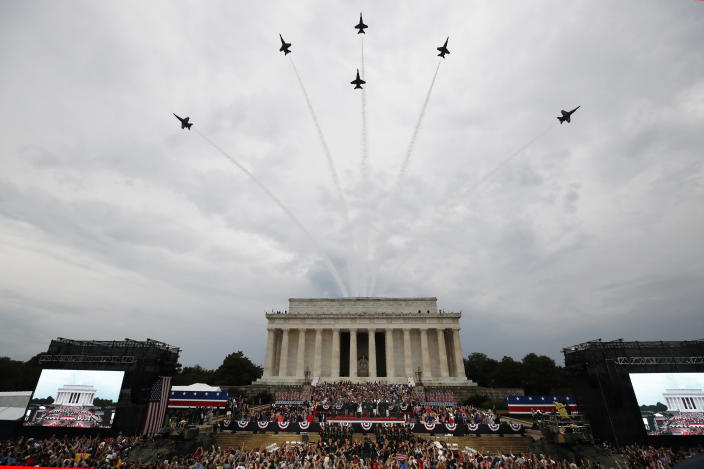 President Donald Trump, first lady Melania Trump, Vice President Mike Pence and Karen Pence and others stand as the US Army Band performs and the US Navy Blue Angels flyover at the end of an Independence Day celebration in front of the Lincoln Memorial, July 4, 2019, in Washington. (Photo: Alex Brandon/AP)