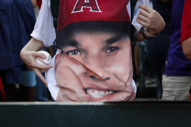 A fan wears a t-shirt with an image of Los Angeles Angels' Mike Trout before the Angels baseball game with the Seattle Mariners, Wednesday, July 11, 2018, in Anaheim, Calif. (AP)