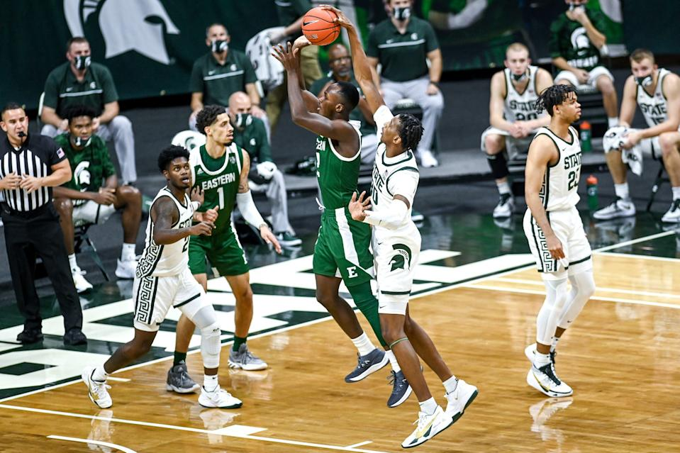Michigan State's Marcus Bingham Jr., right, blocks a shot by Eastern Michigan's Miles Gibson during the first half on Wednesday, Nov. 25, 2020, at the Breslin Center in East Lansing.