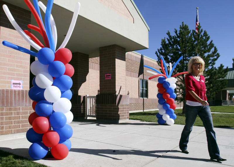 Lisa Gilbert exits Pony Express Elementary School after casting her ballot in Eagle Mountain, Utah, on Election Day, Tuesday, Nov. 6, 2012. (AP Photo/The Salt Lake Tribune, Rick Egan)  DESERET NEWS OUT; LOCAL TV OUT; MAGS OUT