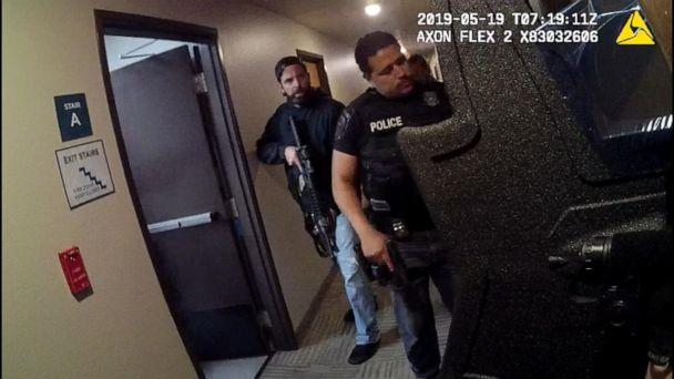 PHOTO: Bodycam footage shows officers surrounding a hotel room at the Woodspring Suites in Forest Hill, Texas, in May. (Obtained by ABC News)