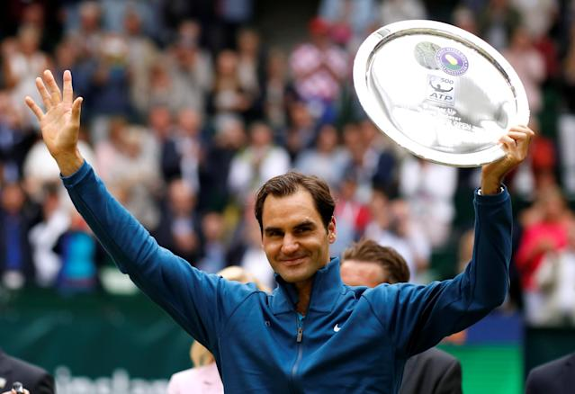 Tennis - ATP - Halle Open Finals - Gerry Weber Stadion, Halle, Germany - June 24, 2018 Switzerland's Roger Federer poses with his runners up trophy after losing the final against Croatia's Borna Coric REUTERS/Leon Kuegeler