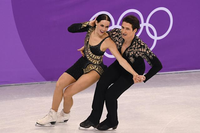 <p>Canada's Scott Moir and Canada's Tessa Virtue compete in the figure skating team event ice dance short dance during the Pyeongchang 2018 Winter Olympic Games at the Gangneung Ice Arena in Gangneung on February 11, 2018. / AFP PHOTO / Roberto SCHMIDT </p>