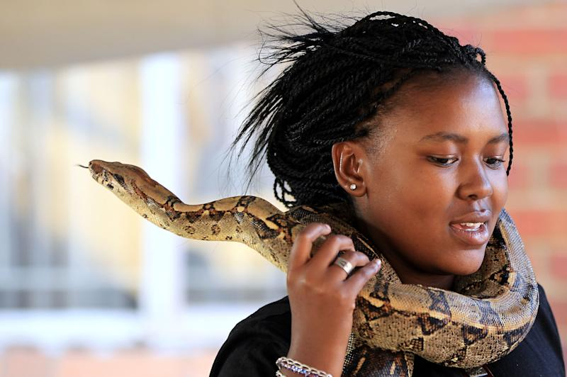 South Africa: Soweto resident shows off her snakes