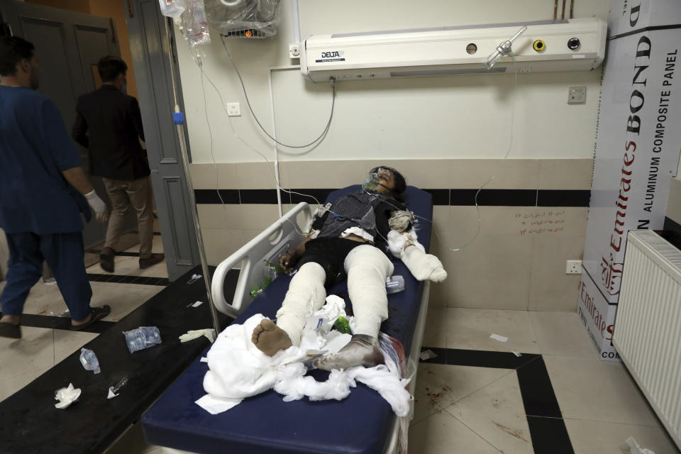 An Afghan school student is treated at a hospital after a bomb explosion near a school in west of Kabul, Afghanistan, Saturday, May 8, 2021. A bomb exploded near a school in west Kabul on Saturday, killing several people, many them young students, an Afghan government spokesmen said. (AP Photo/Rahmat Gul)