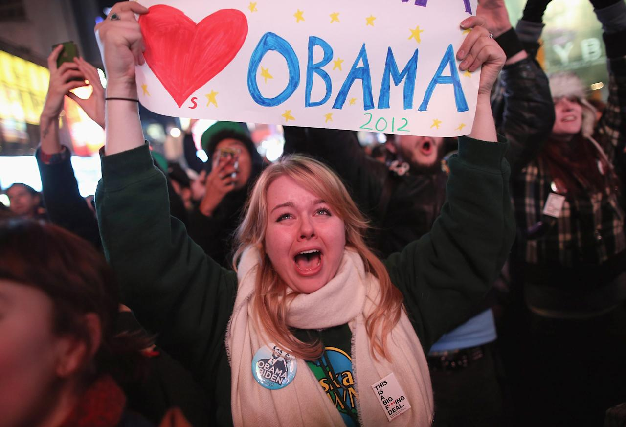 Jessica Clark celebrates with others in Times Square on November 6, 2012 in New York City.  Clark said she voted for the first time in Tuesday's election.  According to network projections incumbent U.S. President Barack Obama has won a second term.  (Photo by John Moore/Getty Images)