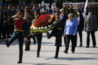 German Chancellor Angela Merkel, center right, attends a wreath laying ceremony at the Tomb of Unknown Soldier in Moscow, Russia, Friday, Aug. 20, 2021, prior to talks with Russian President Vladimir Putin. The talks between Merkel and Putin are expected to focus on Afghanistan, the Ukrainian crisis and the situation in Belarus among other issues. (AP Photo/Alexander Zemlianichenko, Pool)