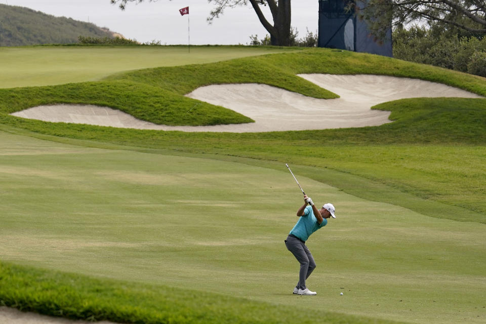 Russell Henley hits from the seventh fairway during the third round of the U.S. Open Golf Championship, Saturday, June 19, 2021, at Torrey Pines Golf Course in San Diego. (AP Photo/Gregory Bull)