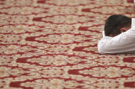 A new priest lie face down on the ground during his ordination ceremony lead by Pope Francis, inside St. Peter's Basilica, at the Vatican, Sunday, April 25, 2021. (AP Photo/Andrew Medichini)