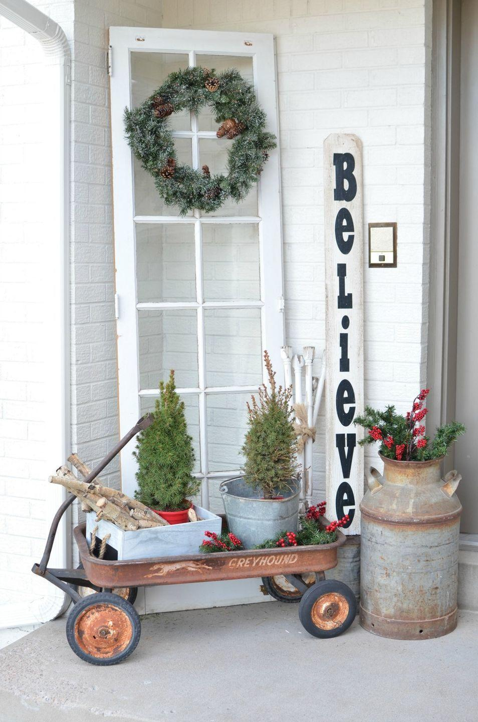 "<p>This porch by <a href=""https://sarahjoyblog.com/christmas-on-the-front-porch/"" rel=""nofollow noopener"" target=""_blank"" data-ylk=""slk:Sarah Joy Blog"" class=""link rapid-noclick-resp"">Sarah Joy Blog</a> doesn't have a lot of Christmas decor, but it still brings the holiday cheer. Sarah Joy keeps the vintage wagon on hand year-round and decorates around it, according to the season. </p>"