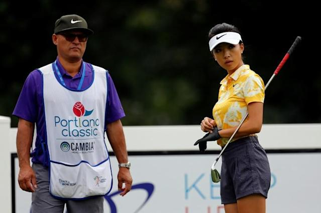 China's Lily Muni He waits with her caddie on the second hole during the first round of the LPGA Tour tournament in Portland, Oregon. Players will have the option of carrying their own bag when the LPGA restarts later this year (AFP Photo/JONATHAN FERREY)