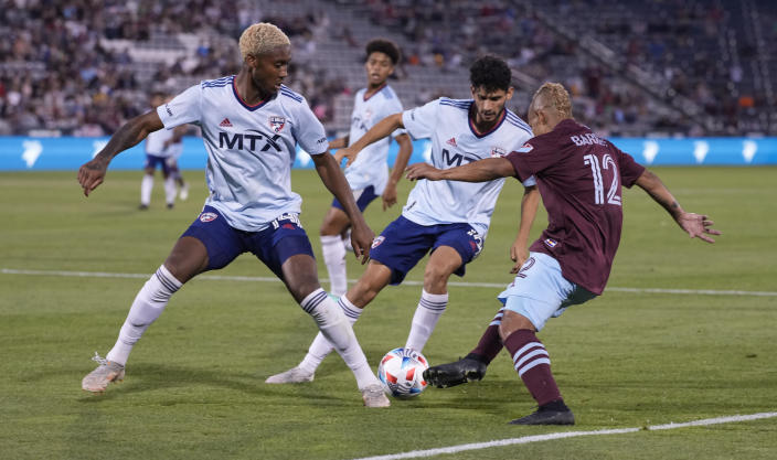 Colorado Rapids forward Michael Barrios, right, loses control of the ball as FC Dallas defender Nkosi Burgess, left, and forward Ricardo Pepi defend during the second half of an MLS soccer match Wednesday, July 21, 2021, in Commerce City, Colo. The Rapids won 2-0. (AP Photo/David Zalubowski)