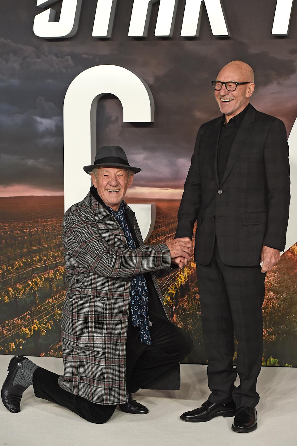 "LONDON, ENGLAND - JANUARY 15: Ian McKellen gets down on one knee for Sir Patrick Stewart on the red carpet during the ""Star Trek Picard"" UK Premiere at Odeon Luxe Leicester Square on January 15, 2020 in London, England. (Photo by Eamonn M. McCormack/Getty Images)"