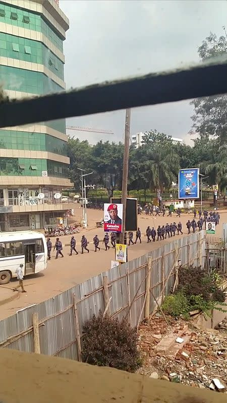 Security officers walk in line in Kampala, Uganda