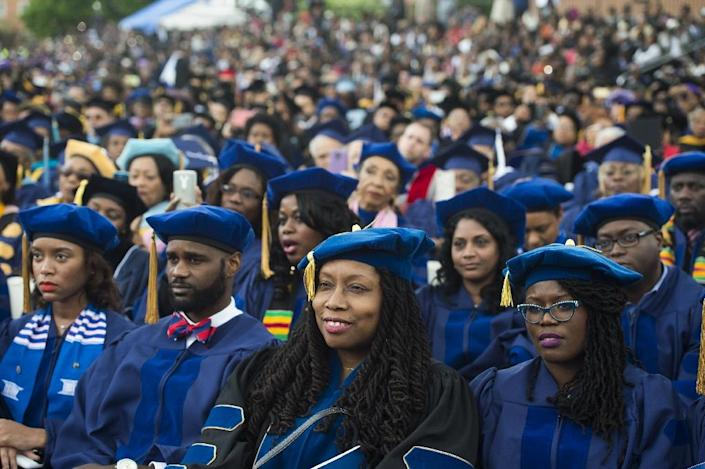 Graduating students listen as US President Barack Obama speaks during the commencement ceremony for Howard University in Washington, DC, on May 7, 2016 (AFP Photo/Saul Loeb)