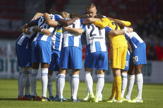 This Saturday, Sept. 14, 2019 taken photo shows Hertha BSC players gather prior to the Bundesliga match against FSV Mainz 05 in Mainz, Germany. Hertha Berlins fresh start under a new coach with additional millions provided by a new backer is not going to plan. Hertha has only one point from four Bundesliga games, its laudable 2-2 draw at defending champion Bayern Munich now but a distant memory after three straight defeats. (Thomas Frey/dpa via AP)