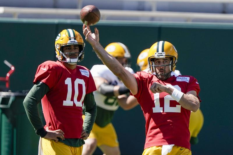 Green Bay Packers' Jordan Love watches Aaron Rodgers throw during NFL football practice Friday, Sept. 4, 2020, in Green Bay, Wis. (AP Photo/Morry Gash)