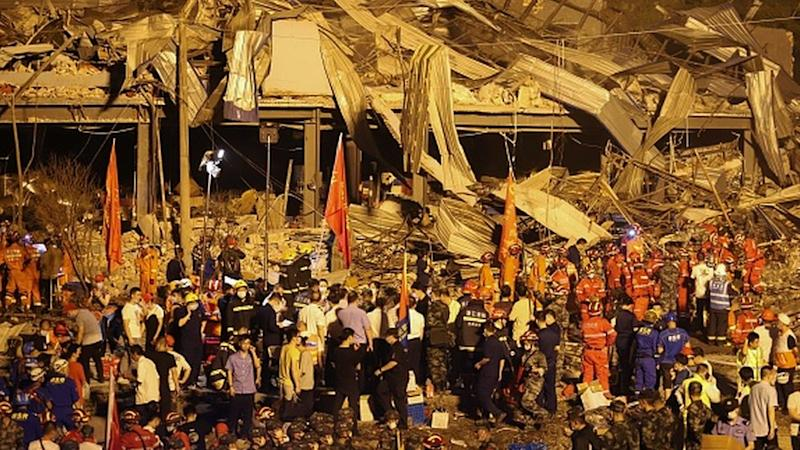 Rescuers searching for survivors in a building damaged by a tanker explosion near Wenling, in China's eastern Zhejiang province