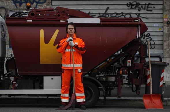 Francesco Foglia, 37, poses for a picture as he works as a street sweeper in downtown Rome, April 29, 2012. Foggia studied for six years at university in Rome where he received a degree and a doctorate in industrial chemistry. He hoped to find a job as a researcher but has been working as a street sweeper for Rome's municipality for two years.