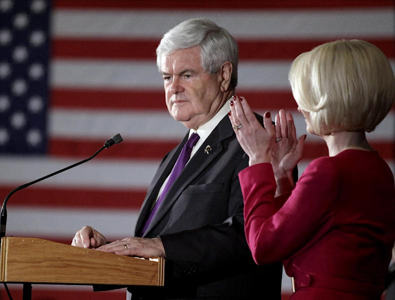 Republican presidential candidate former House Speaker Newt Gingrich, left, speaks as wife Callista applauds during the Alabama primary night rally Tuesday, March 13, 2012, in Birmingham, Ala. (AP Photo/David Goldman)