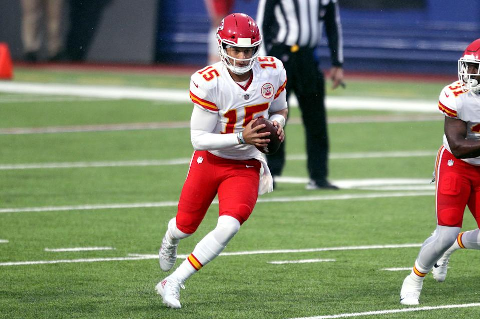 Patrick Mahomes #15 of the Kansas City Chiefs scrambles with the ball against the Buffalo Bills during the first half at Bills Stadium on October 19, 2020 in Orchard Park, New York. (Photo by Bryan M. Bennett/Getty Images)