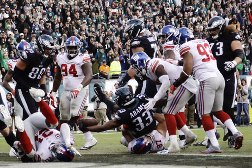 Philadelphia Eagles' Josh Adams (33) scores a two-point conversion during the second half of an NFL football game against the New York Giants, Sunday, Nov. 25, 2018, in Philadelphia. (AP Photo/Michael Perez)