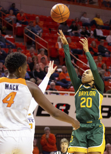 Oklahoma State forward Natasha Mack (4) watches as Baylor guard Juicy Landrum (20) shoots during the second half of an NCAA college basketball game in Stillwater, Okla., Saturday, Feb. 15, 2020. (AP Photo/Brody Schmidt)