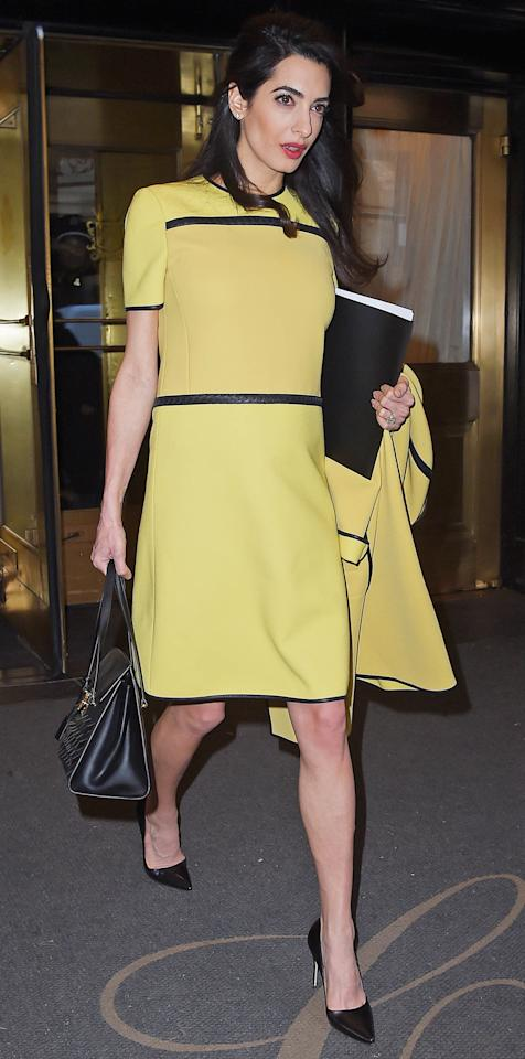 <p>Amal Clooney delivered a powerful call for action at the United Nations in a stunning daffodil dress and matching coat. The accomplished international human rights lawyer addressed one of the world's most critical humanitarian threats while wearing a chic yellow ensemble with contrasting detailing.</p>