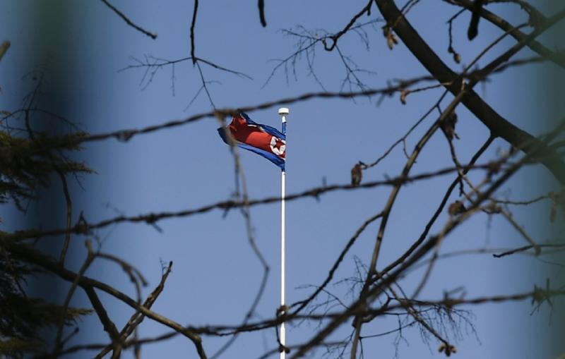 The North Korean national flag flies at the North Korean Embassy in Beijing. China remains the reclusive state's main provider of aid and trade