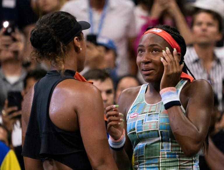 Coco Gauff, right, was consoled by Japan's Naomi Osaka after a US Open singles loss Saturday but the American was smiling again after a doubles victory Sunday with partner Caty McNally (AFP Photo/Don Emmert)