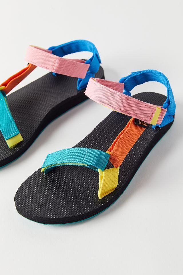 """<h2>Cheap Athletic Sandals</h2><br>Whether it's a rainbow-hued <a href=""""https://www.refinery29.com/en-us/teva-style-sandals"""" rel=""""nofollow noopener"""" target=""""_blank"""" data-ylk=""""slk:pair of Tevas"""" class=""""link rapid-noclick-resp"""">pair of Tevas</a>, Birkenstock's brightly colored EVA foam-rubber slides, or Merrell's adorably monstrous rubber clog, the sporty-sandal options are plentiful this summer. <br><br><strong>Teva</strong> Original Universal 90s Multi Sandal, $, available at <a href=""""https://go.skimresources.com/?id=30283X879131&url=https%3A%2F%2Fwww.urbanoutfitters.com%2Fshop%2Fteva-original-universal-90s-multi-sandal"""" rel=""""nofollow noopener"""" target=""""_blank"""" data-ylk=""""slk:Urban Outfitters"""" class=""""link rapid-noclick-resp"""">Urban Outfitters</a>"""