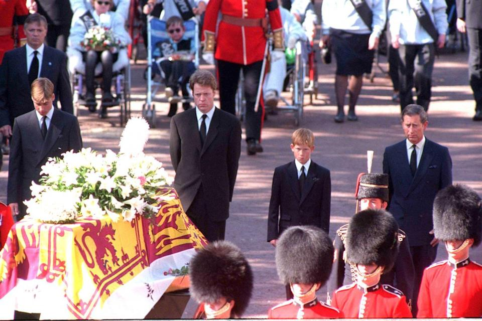 The young princes stand behind their mother's coffin at the funeral at Westminster Abbey (Adam Butler/PA)
