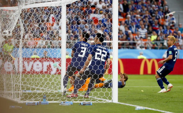 From left, Japan's Gen Shoji, Maya Yoshida and Yuto Nagatomo look as the ball enters their goal as Senegal's Moussa Wague scored his side's second goal past during the group H match between Japan and Senegal at the 2018 soccer World Cup at the Yekaterinburg Arena in Yekaterinburg , Russia, Sunday, June 24, 2018. (AP Photo/Natacha Pisarenko)