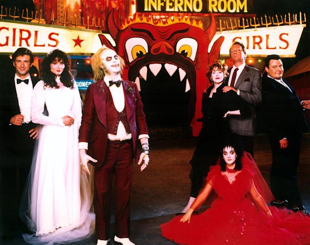Alec Baldwin, Geena Davis, Michael Keaton, Catherine O'Hara, Winona Ryder, and Jeffrey Jones in <em>Beetlejuice.</em> (Photo: Warner Bros./Courtesy of Everett Collection)